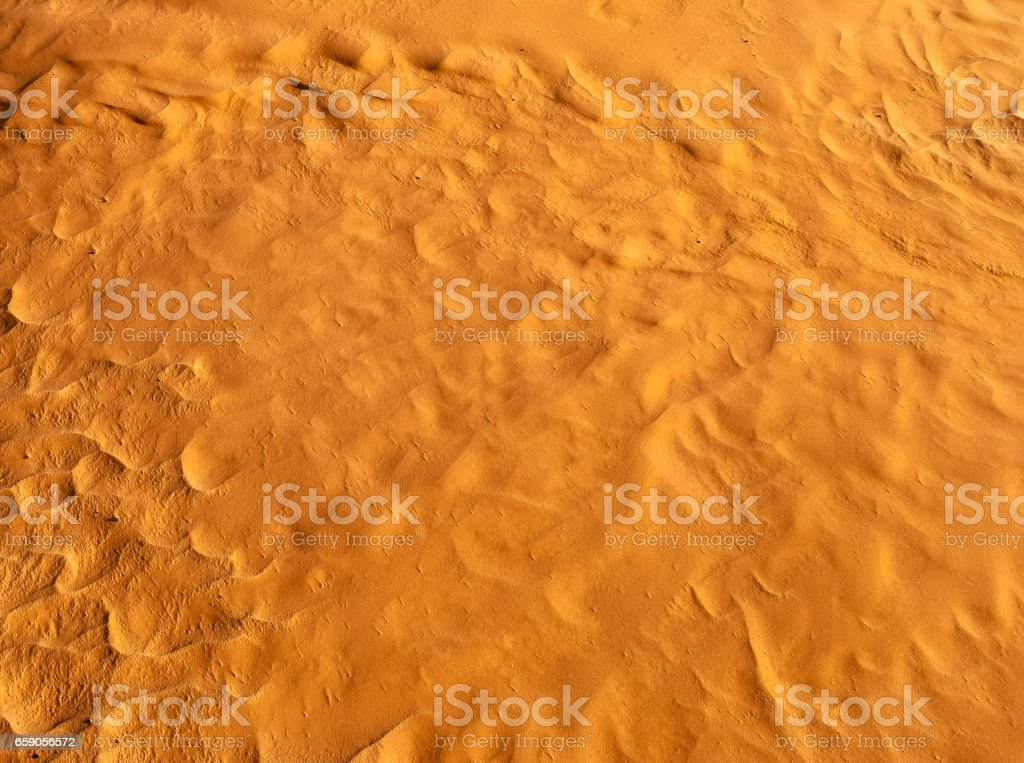 Golden brown surface color. Desert. Modern and contemporary wallpaper for interior design. Background and Texture royalty-free stock photo