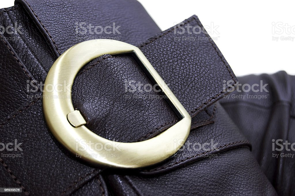 Golden buckle of leather brown boot royalty-free stock photo