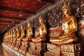 Golden Buddha at corridor, Wat Suthat temple, Thailand