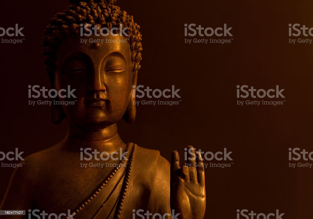 A golden Buddha holding out his hand stock photo