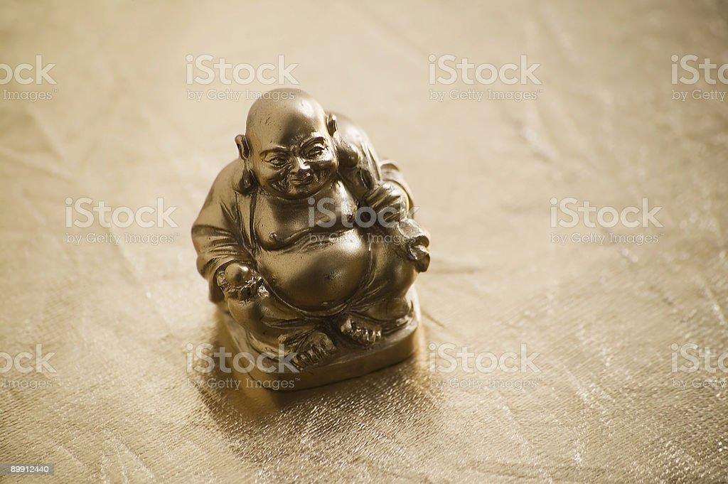 Golden Buddha on Shiny Surface royalty-free stock photo