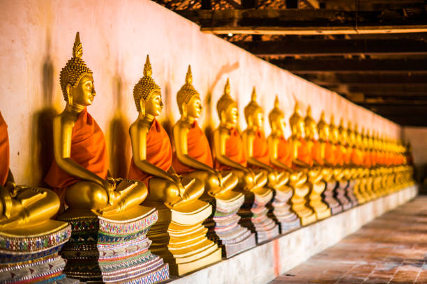 Golden Buddha Sorted in ancient temples. stock photo