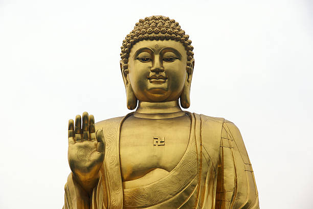 golden buddha statue closeup stock photo