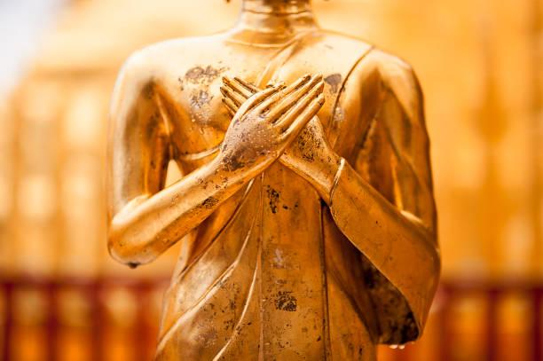 Golden Buddha statue close-up stock photo