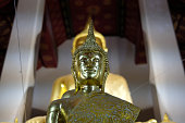 golden buddha statue image at temple of dawn in Bangkok, Thailand
