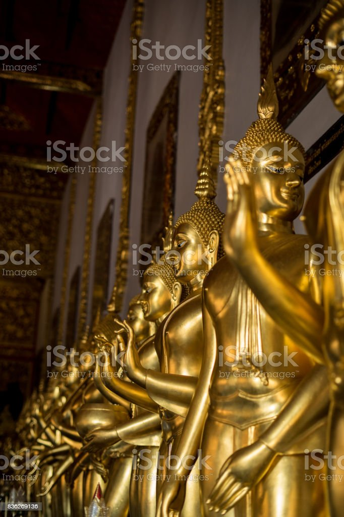 Golden buddha statue in buddhism temple thailand / Asia Travel stock photo