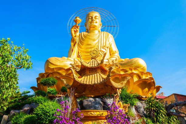 Golden Buddha statue in Dalat stock photo