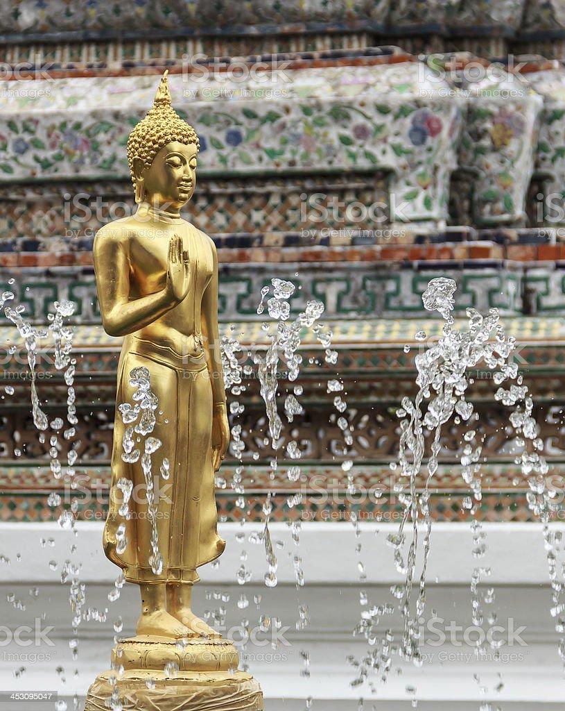 Golden Buddha Statue in Fountain stock photo