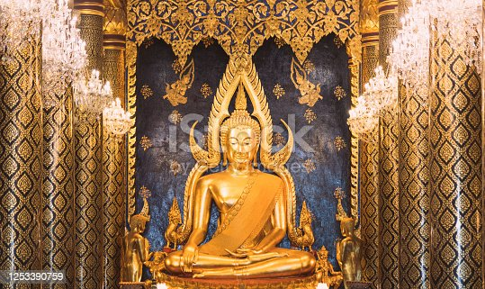Golden Buddha statue in Temple (Wat ) decorated in beautiful lighting and interior most popular buddish temple in bangkok thailand