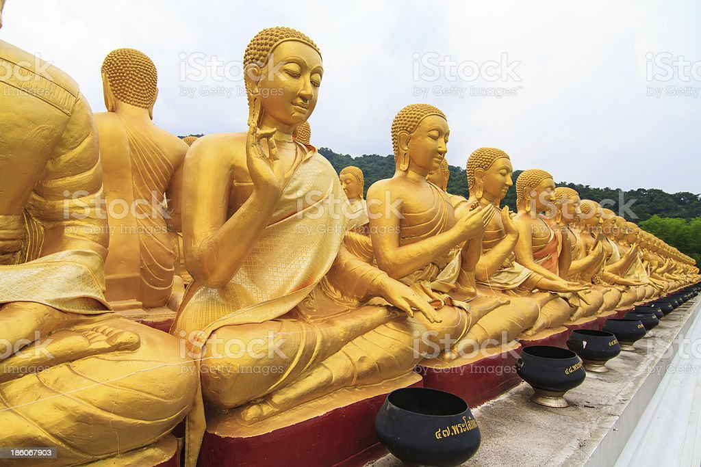 Golden buddha statue in thai temple stock photo