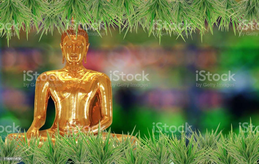 Golden Buddha statue on background religion sign.