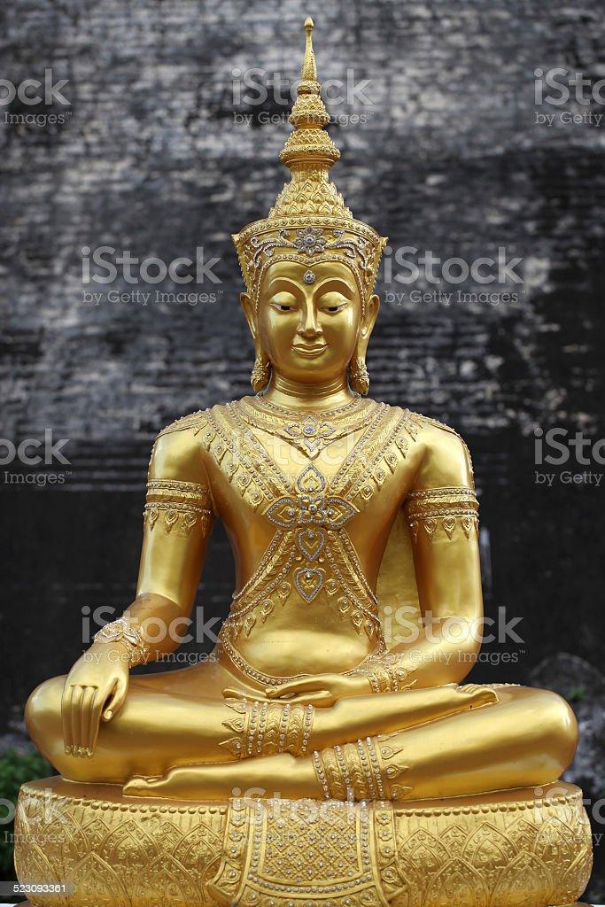Golden Buddha statue stucco stock photo