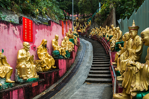 Golden Buddha Statues Along The Stairs Leading To The Ten Thousand Buddhas Monastery Hong Kong Sha Tin New Territories Stock Photo - Download Image Now