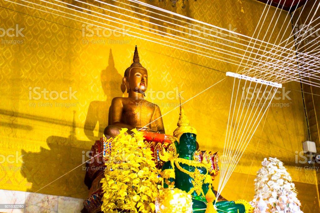 Golden Buddha statues at the temple Luang Poh Pag Dang Nakonnayok stock photo