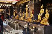 Chiang Mai, Thailand - November 12, 2008: Golden Buddha statues in Wat Phra That Doi Suthep, Buddhist temple in Chiang Mai, Thailand.