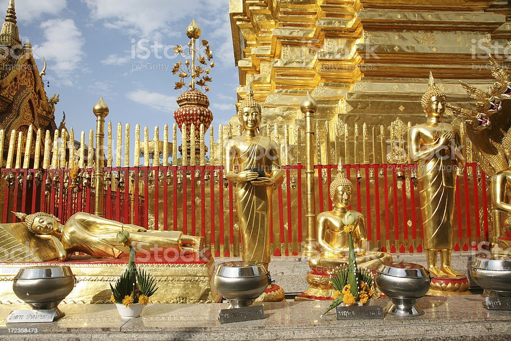 Golden Buddha Statutes And Religious Offerings royalty-free stock photo