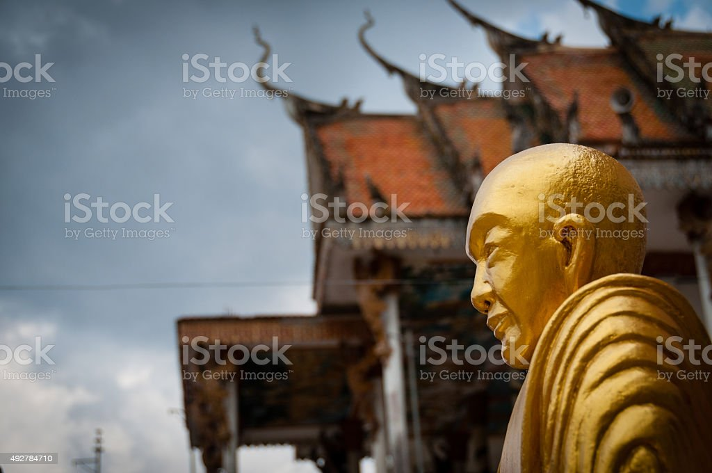 Golden Buddha with beautiful ancient temple in Laos stock photo