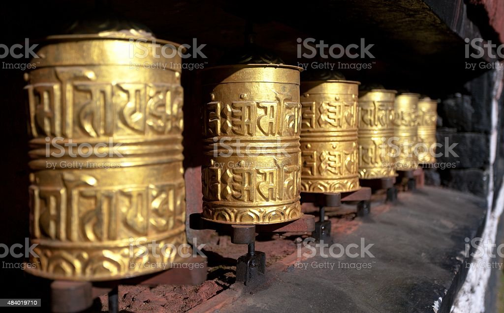 golden buddhist prayer wheels stock photo