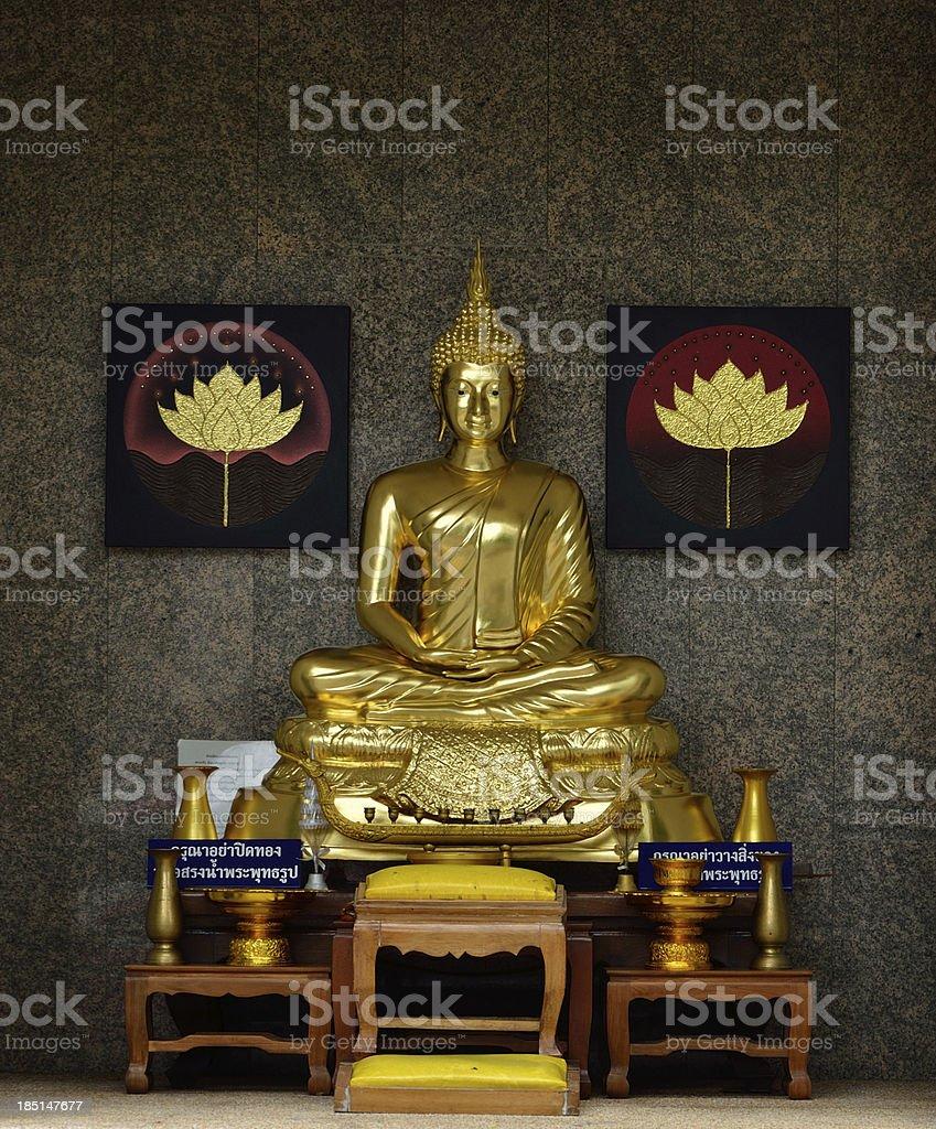Golden Buddhist statue royalty-free stock photo