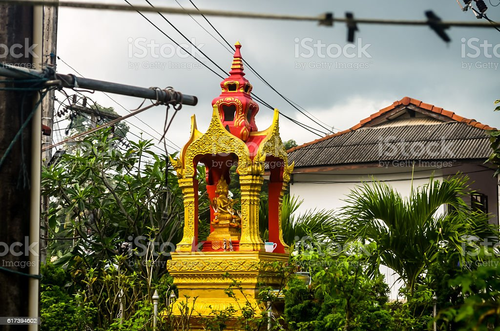 golden buddhistic sprit house in tropical nature stock photo