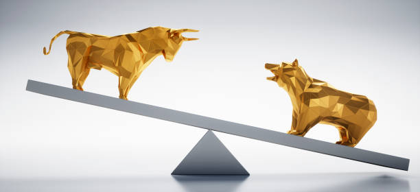 Golden Bull and Bear on Seesaw Low Poly faceted Bull and Bear standing on a Seesaw  with a white shiny Background bull market stock pictures, royalty-free photos & images