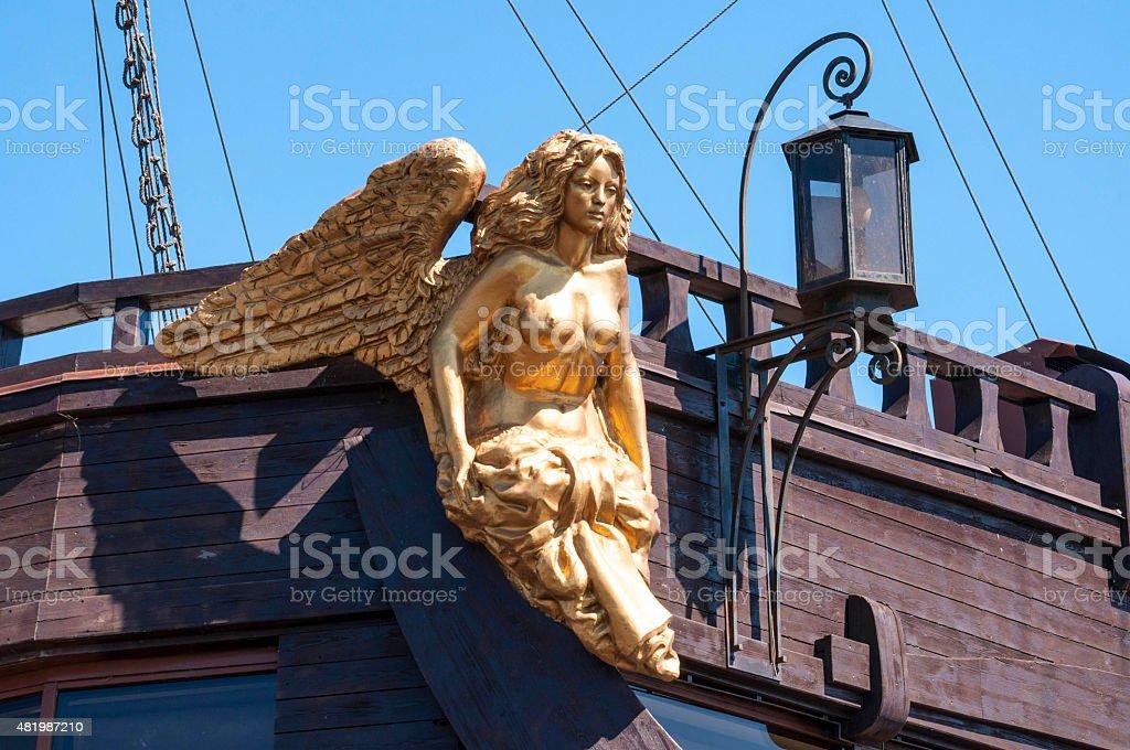 Golden caryatid in the big sailing ship stock photo