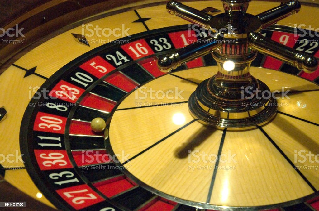 Golden Casino roulette, poker game, dice game, poker chips on a...