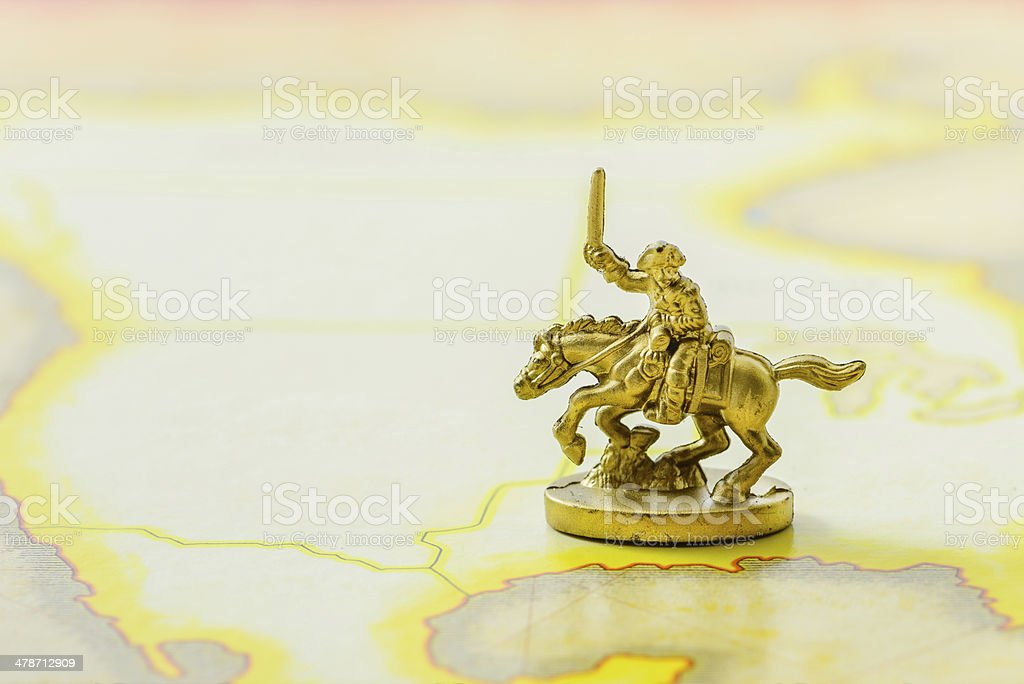 Golden Cavalry Model on a map stock photo
