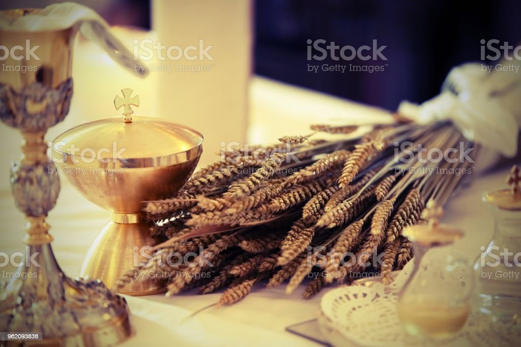 golden chalice and little bottle with wine on an altar in a chur stock photo