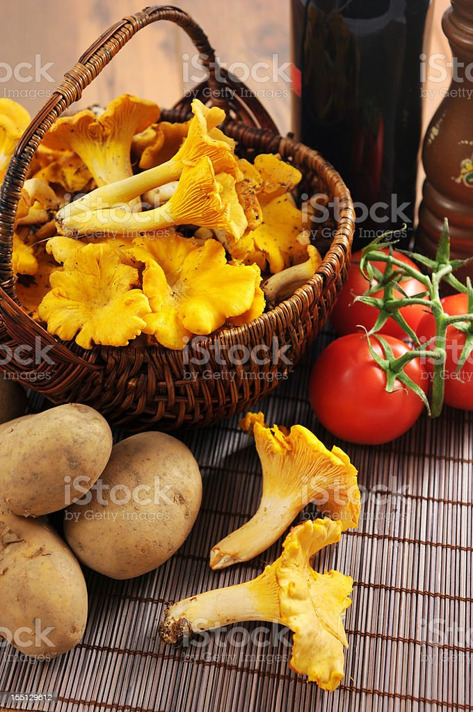 golden chanterelle mushroom (Cantharellus cibarius) with tomates and potatoes royalty-free stock photo