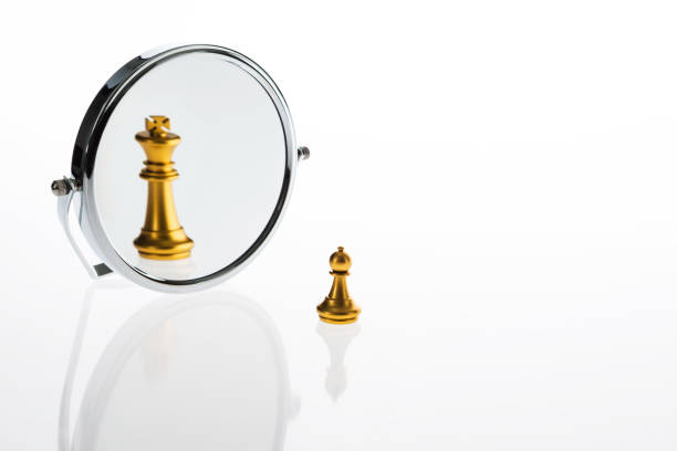 Golden chess pawn imagining itself as a king stock photo