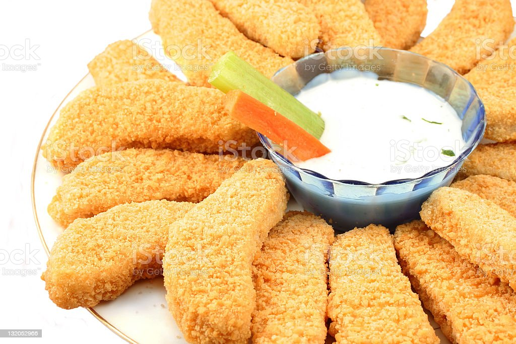 Golden chicken fingers and veggies royalty-free stock photo
