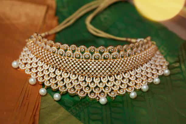 golden chocker necklace in good lighting stock photo