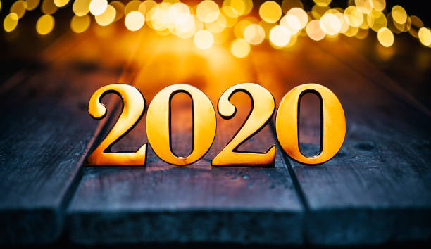 Golden Christmas 2020 - Gold Metal Lights Wood New Year stock photo