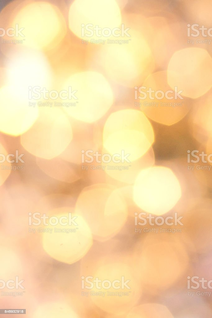 Golden Christmas background with natural  bokeh and twinkled defocused lights. Festive blur background 'n stock photo