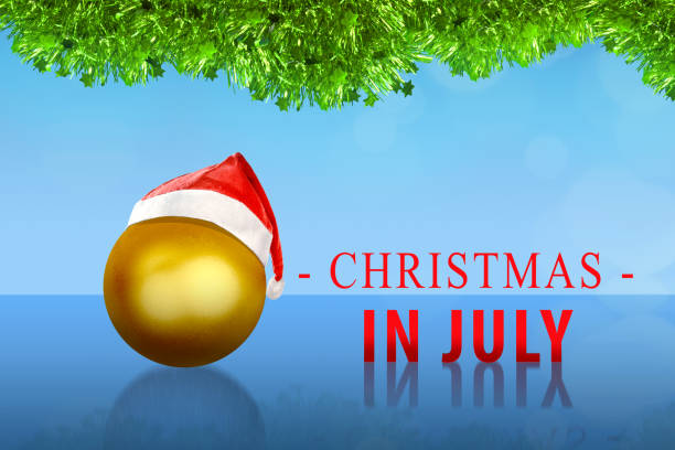 golden christmas ball with santa hat on christmas in july - july stock photos and pictures