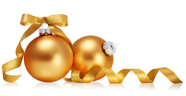 Golden christmas balls with ribbon isolated over white background. stock photo