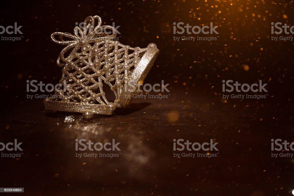 Golden Christmas bells on a dark wooden background stock photo