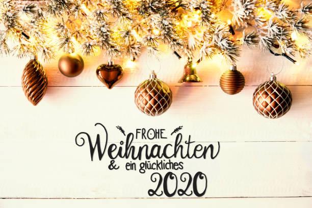 Golden Christmas Decoration, Fir Branch, Glueckliches 2020 Means Happy 2020 – Foto