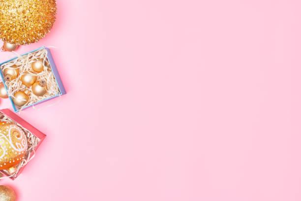 Golden christmas decoration on pastel pink background copyspace picture id1267338394?b=1&k=6&m=1267338394&s=612x612&w=0&h=r7bkz4mrweiqgkn3 wf bqitcb4aq5auoeicupnfok4=