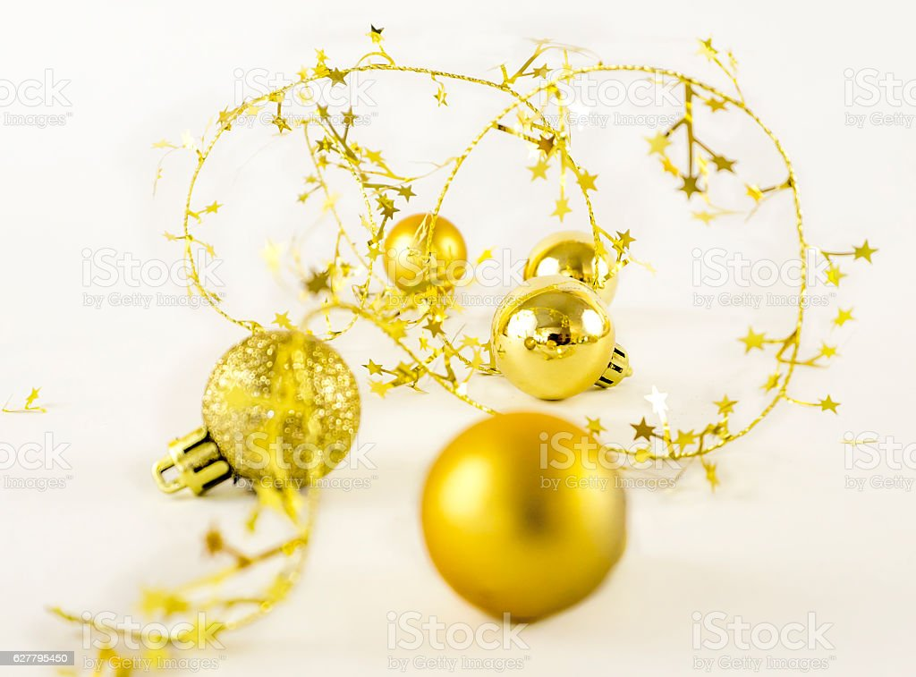 Golden christmas decoration with a white background stock photo