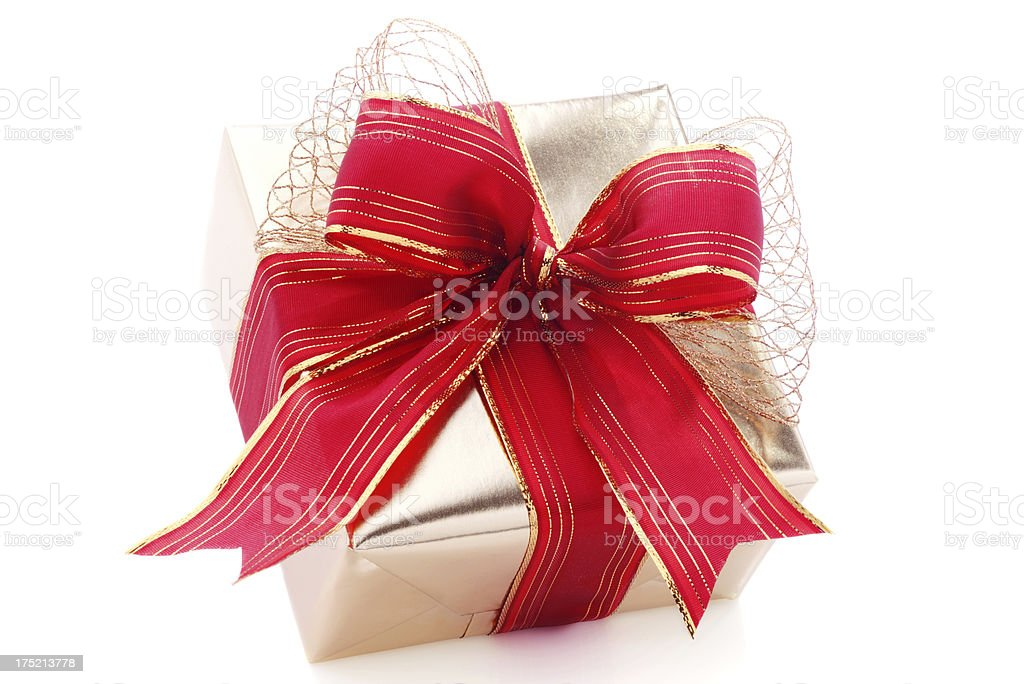 Golden christmas gift on isolated white royalty-free stock photo