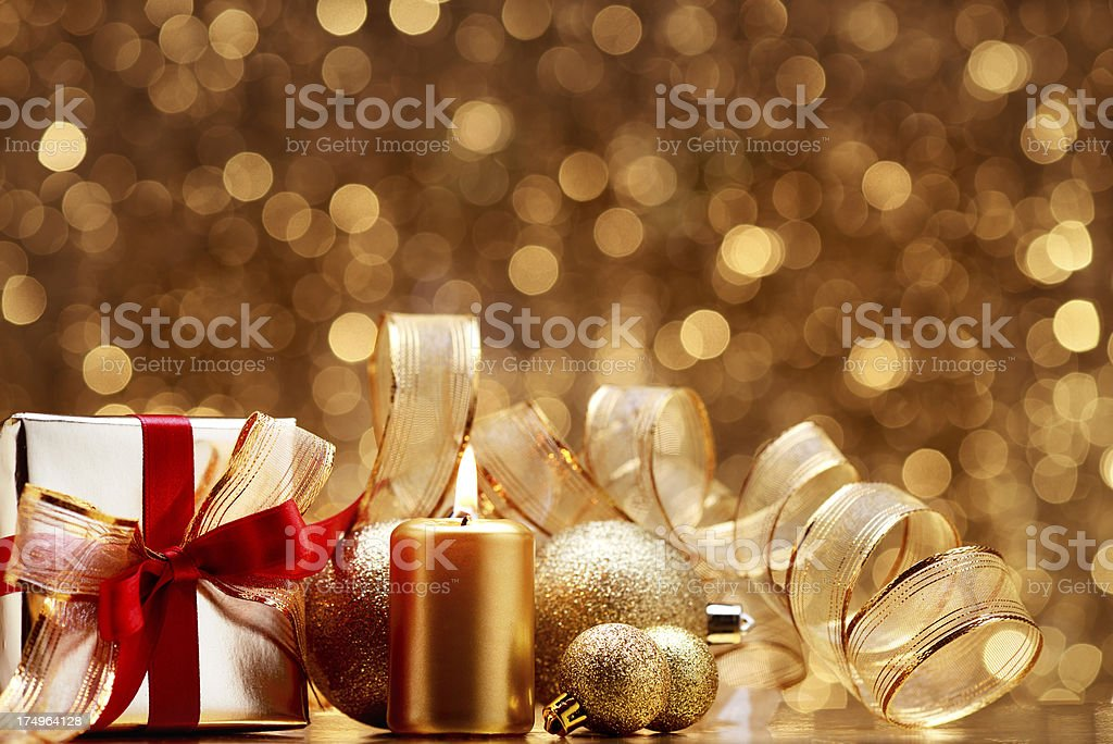Golden christmas gift with decoration royalty-free stock photo