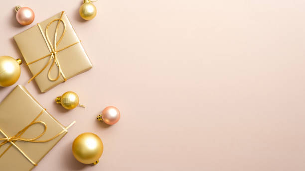 Golden christmas gifts and balls on pastel beige background with copy picture id1186453621?b=1&k=6&m=1186453621&s=612x612&w=0&h=6kuk 7ancua huzmk3 eb63eeku3qooy mek33ouynw=