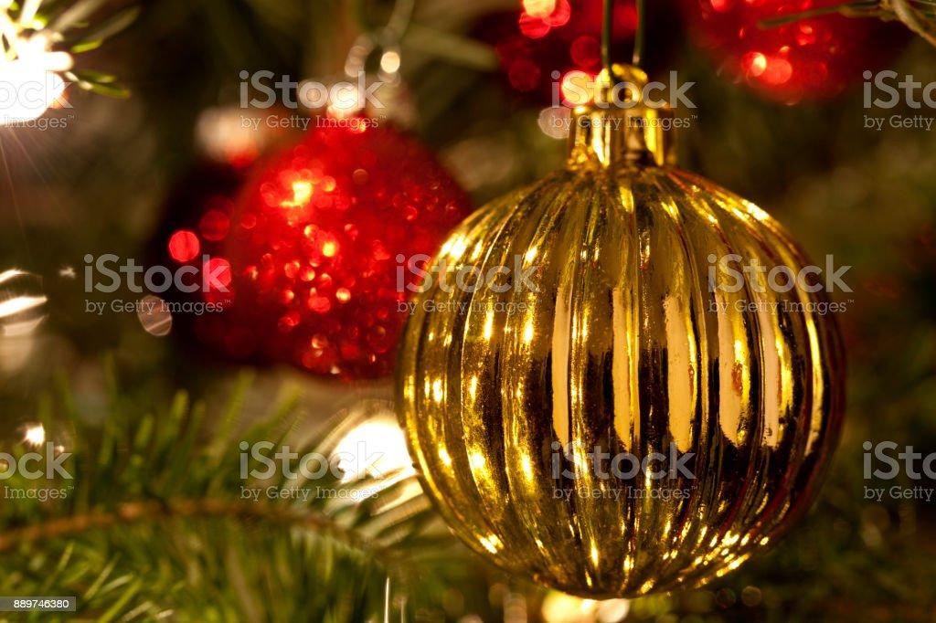 Tungsten light enhances the holiday look of Christmas tree balls on...