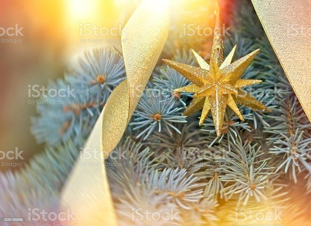 Golden Christmas star - Christmas decoration stock photo