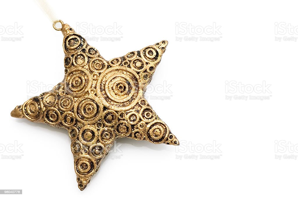 Golden Christmas star decoration with swirls on white royalty-free stock photo