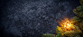 Photography of a golden Christmas star on dark metal. Panoramic image stich.