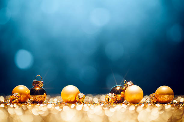 golden christmas time - decorations lights bokeh defocused blue gold - holidays and seasonal stock pictures, royalty-free photos & images