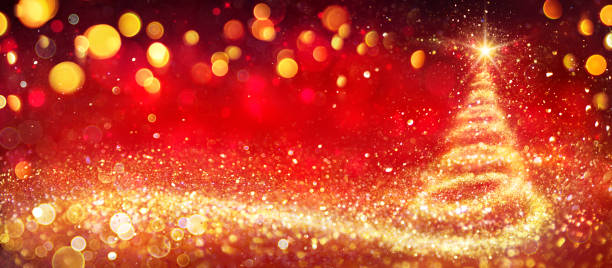 Golden Christmas Tree In Red Festive Background stock photo
